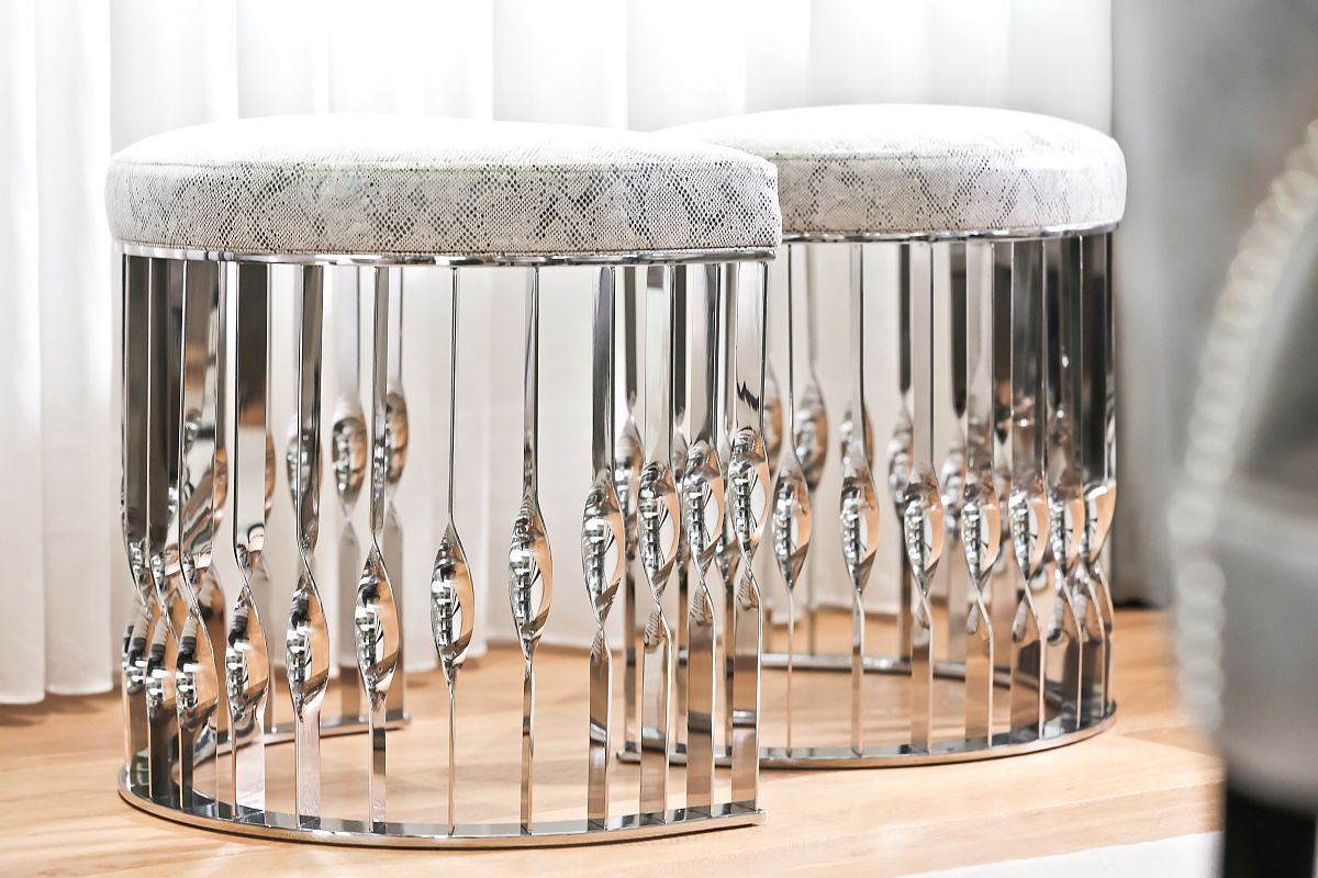 Custom upholstered Mandy stools froom KOKET with stunning stainless steel finish