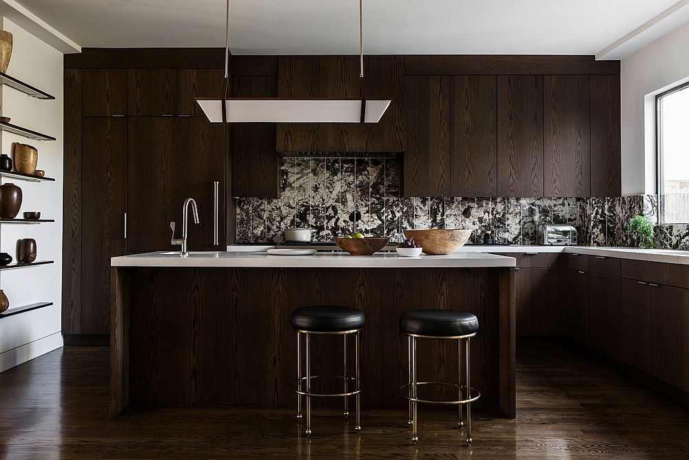 Dark wooden cabinets and a unique backsplash create a stunning modern kitchen