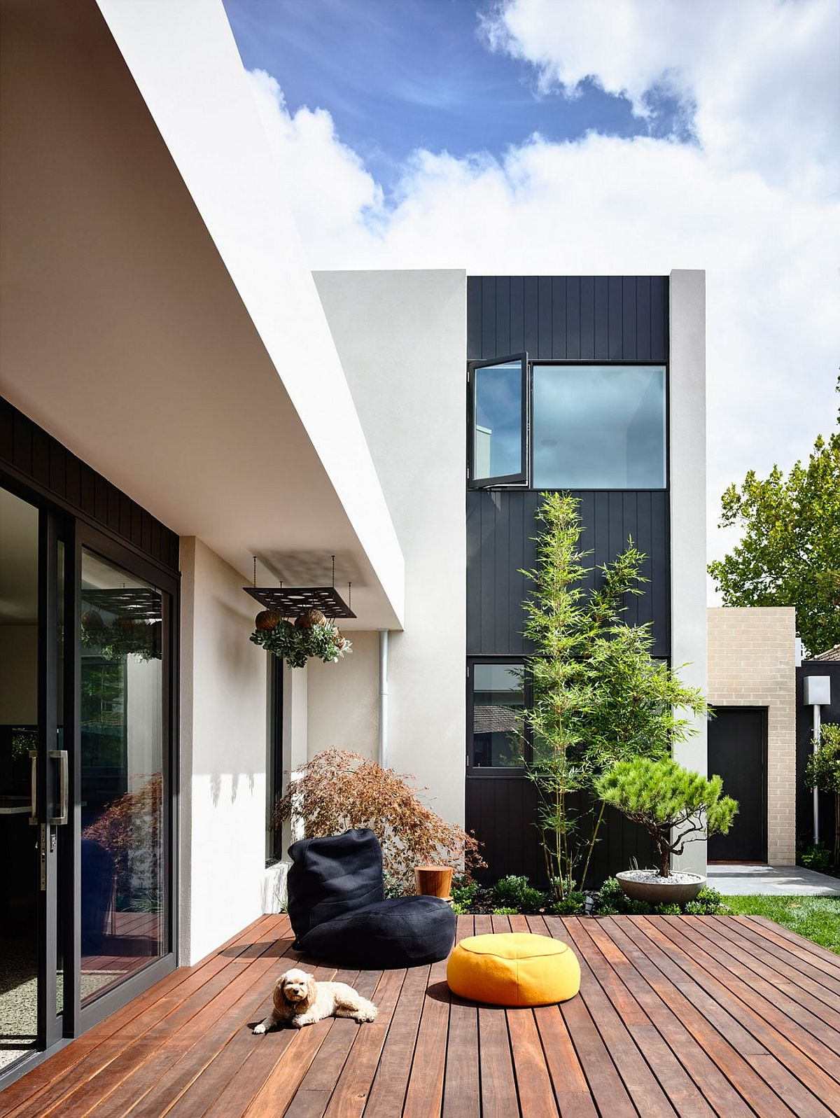 Dark wooden panels add visual contrast to the exterior of the house
