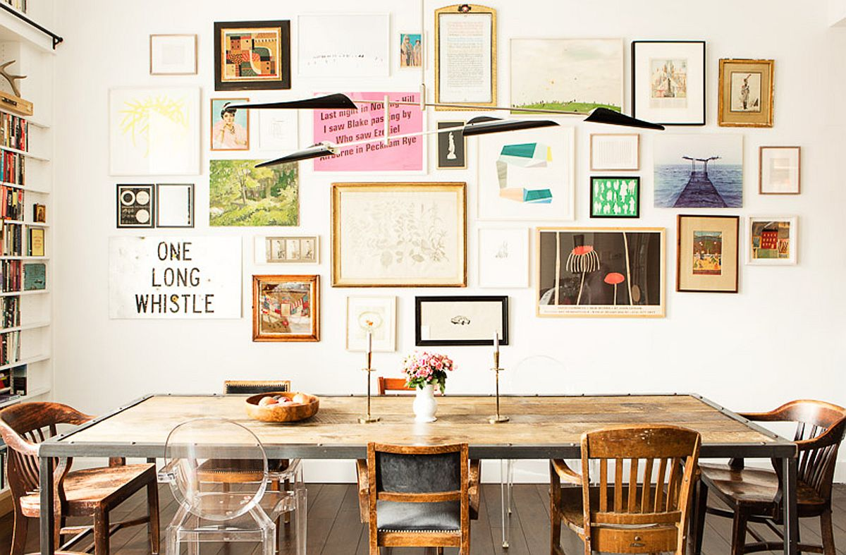 Dining area of the open living with wall art on display