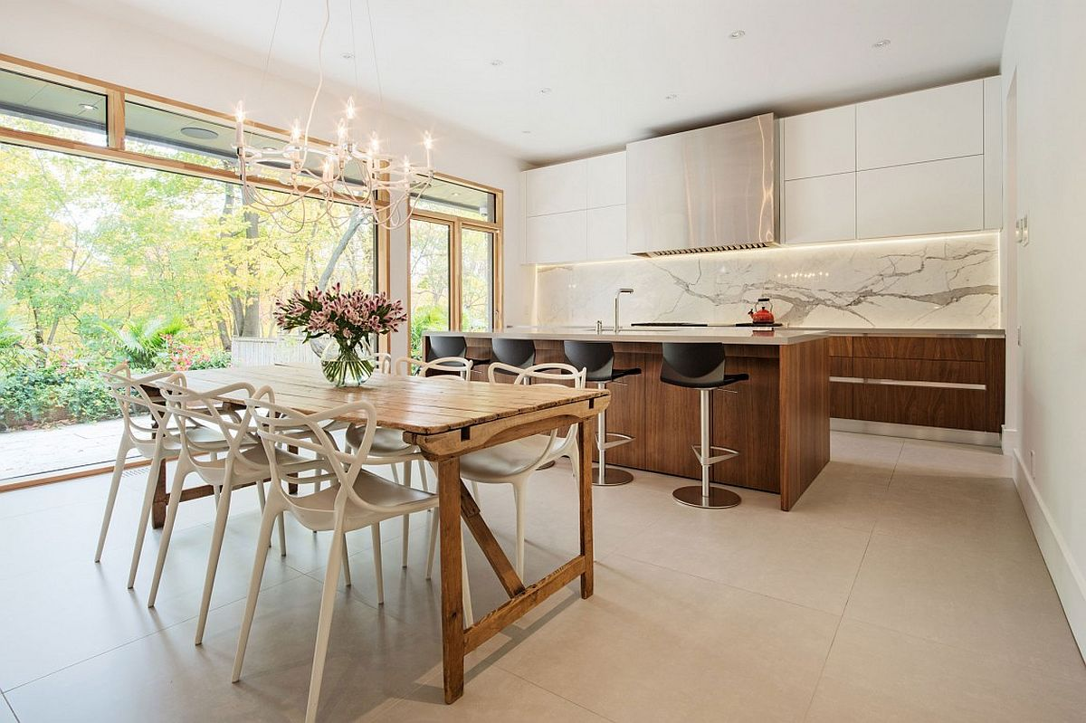 Dining room and kitchen with a cool marble backsplash