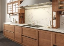 Distinctive hood adds to the traditional appeal of the kitchen