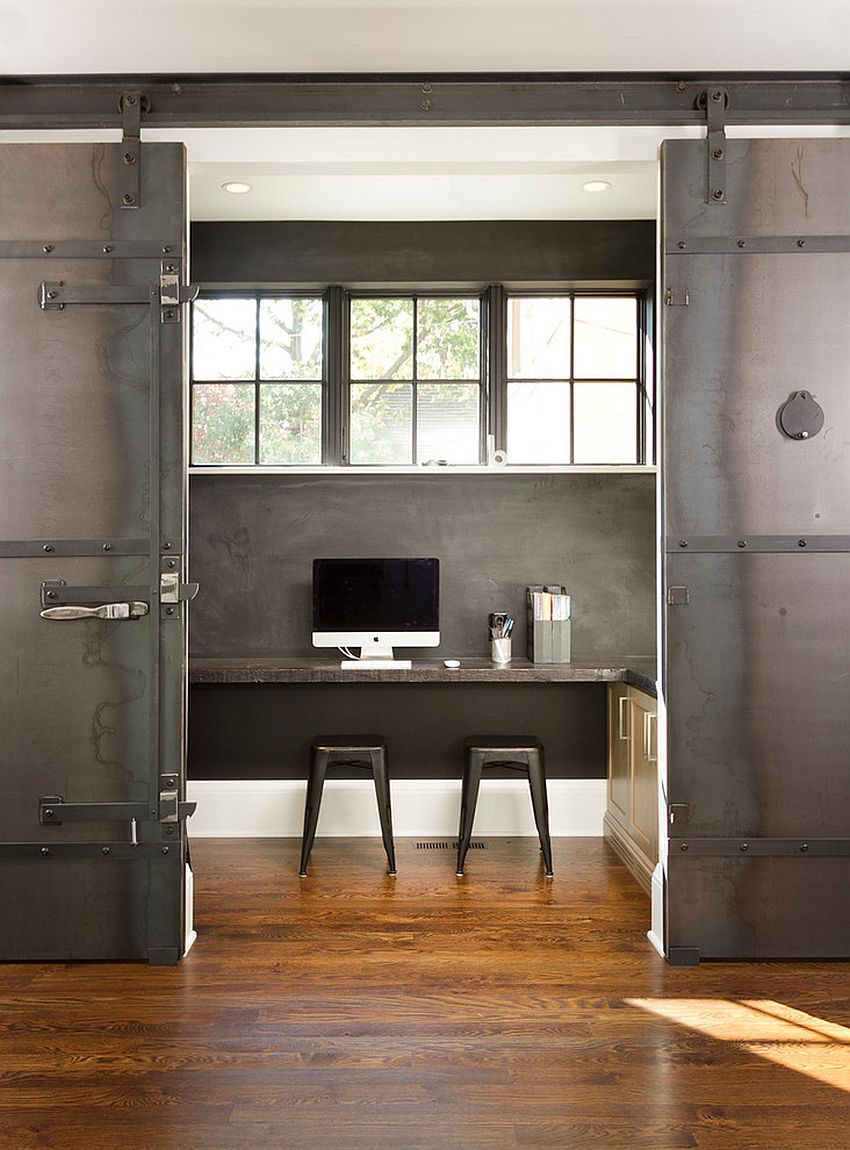 Dramatic sliding doors separate the small home office from kitchen and dining area [Design: w.b. builders]