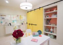 Eclectic-basement-home-office-with-colorful-barn-doors-217x155