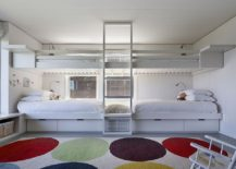 Eclectic-rug-adds-bright-pops-of-color-in-a-refined-fashion-to-the-beach-style-kids-room-217x155