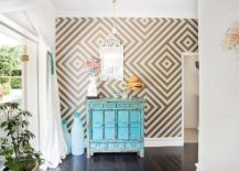 Eclectic with vintage credenza and geometric wallpaper