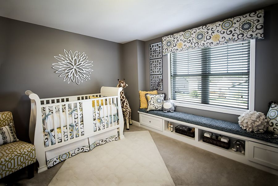Even the smallest hints of yellow shine through brightly in a nursery with neutral gray backdrop [Design: Veridian Homes / Photography: Jaclyn Tyler]