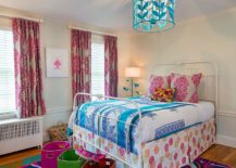 Eye-catching rug from Anthropologie and lighting fixture complement one another