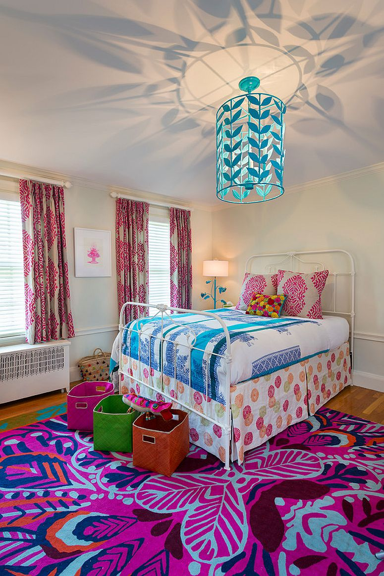 Eye-catching rug from Anthropologie and lighting fixture complement one another [From: Woodward Leach Design]