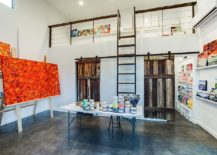 Fabulous art studio with barn doors leading to the area that stores away the supplies