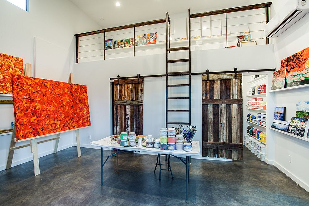 Fabulous art studio with barn doors leading to the area that stores away the supplies [Design: Richardson Residential]