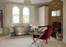 Fireplace-and-a-bright-red-armchair-along-with-side-table-transform-the-transitional-bathroom-217x155