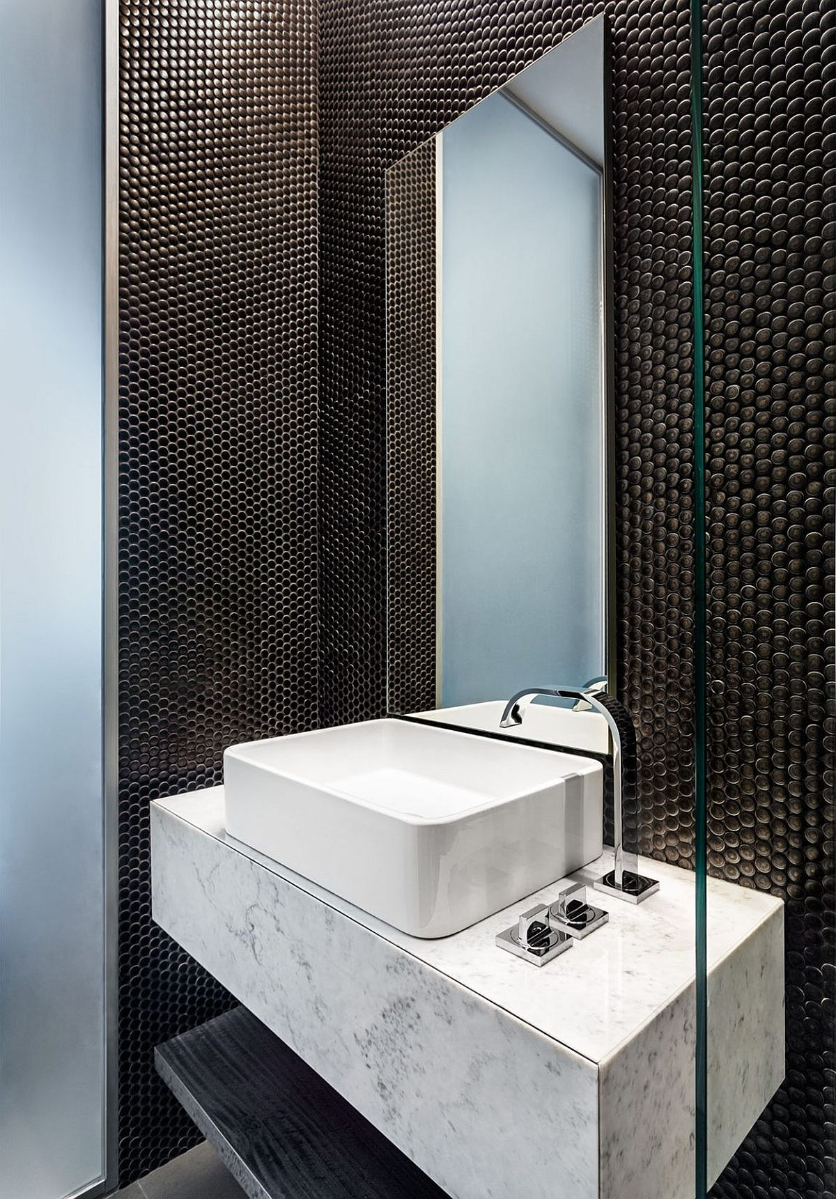 Floating marble vanity makes a bigger visual impact thanks to the black backdrop