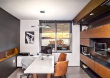 Floating-wooden-cabinets-provide-the-perfect-storage-option-inside-the-stuido-217x155