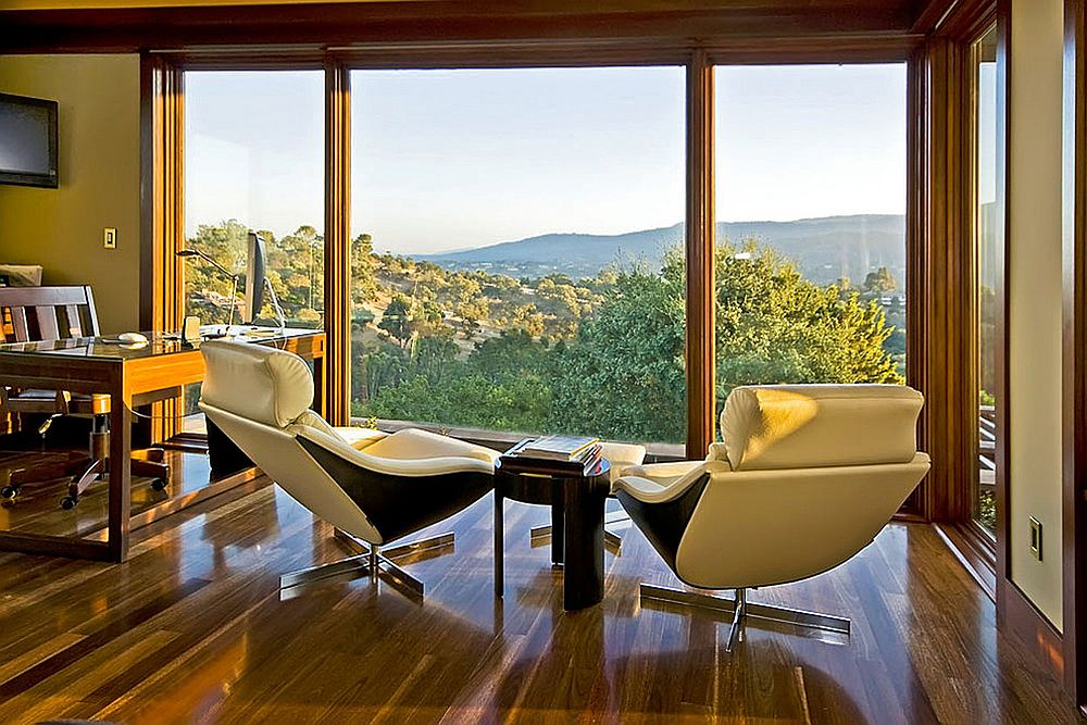Floor-to-ceiling windows open up the home office to the lovely view outside