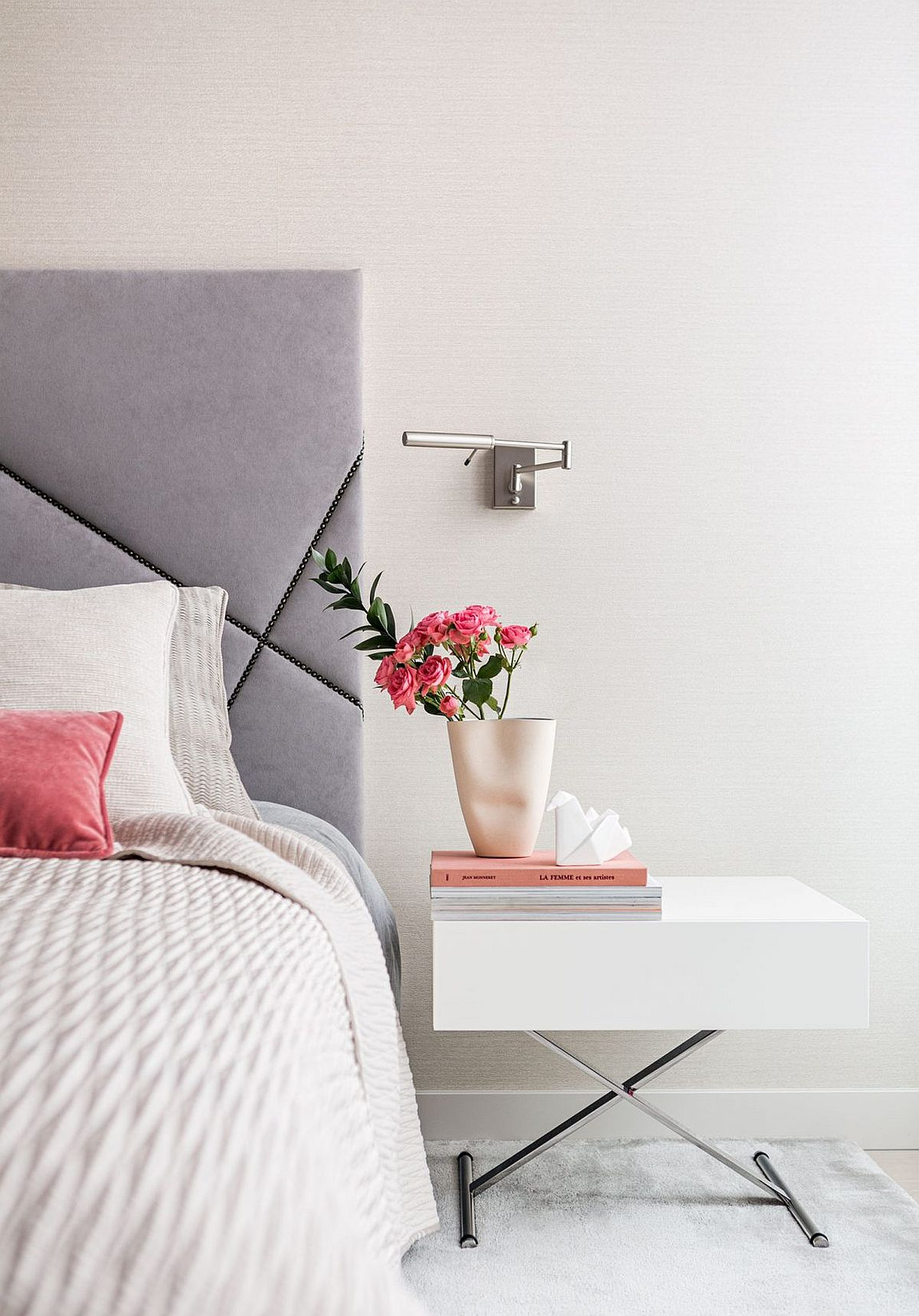 Flower on the nightstand bring a feminine touch to the luxurious bedroom