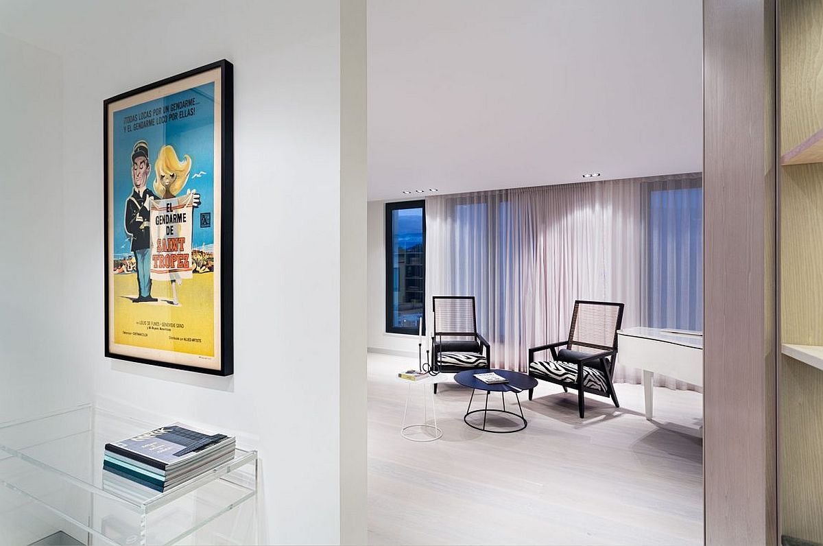 Framed poster brings color and excitement to the neutral penthouse interior