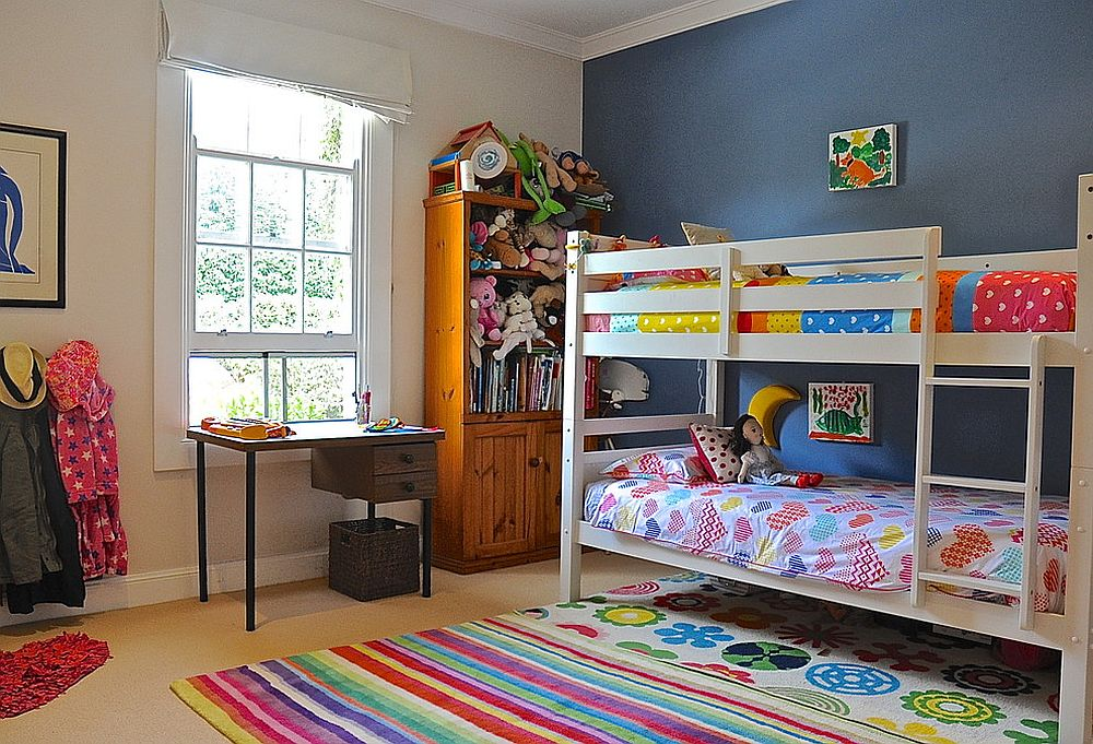 Fun girls' bedroom mixes and matches various colors and patterns