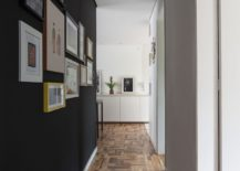 Gallery wall leads way to the bedrooms from the living space