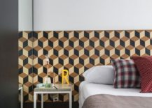 Geometric wallpaper with 3D design spices up the bedroom
