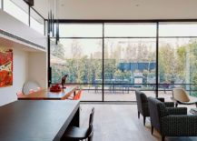 Glass walls provide protection from the elements while keeping the interior connected with the backyard
