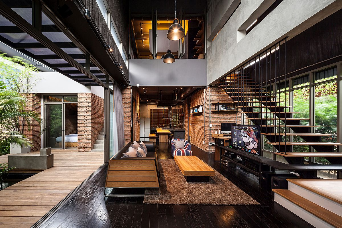 Gorgeous industrial living room of one of the Two Houses in Bangkok, Thailand