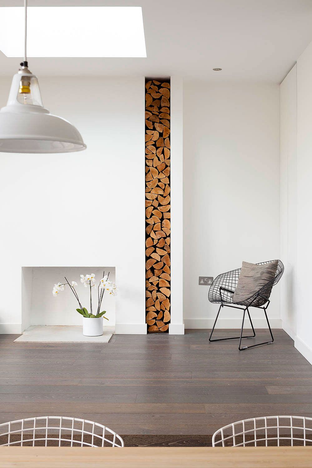 Gorgeously stacked firewood adds a new texture to the contemporary interior