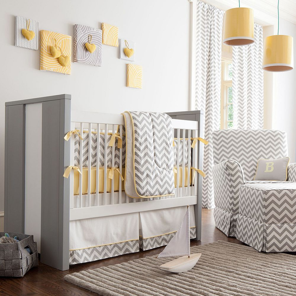 Gray and white chevron stripes coupled with pops of yellow in the contemporary nursery [Design: Carousel Designs]