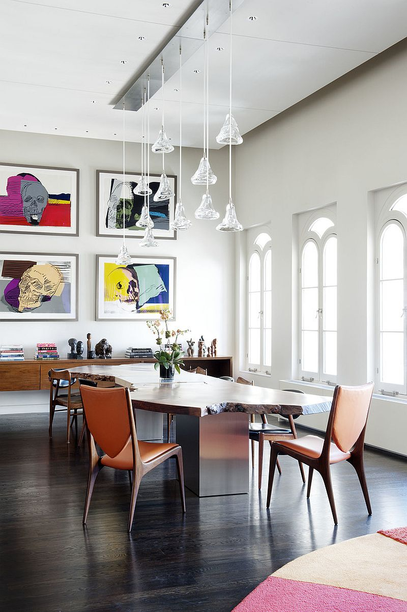 High ceiling, lovely windows and beautiful pendants give the dining room a cheerful ambiance