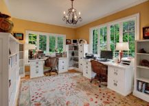 Home-office-for-a-couple-makes-complete-use-of-the-corner-space-on-offer-with-open-shelving-and-cabinets-217x155