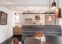 Impressive natural stone kitchen island inside the Belgian home