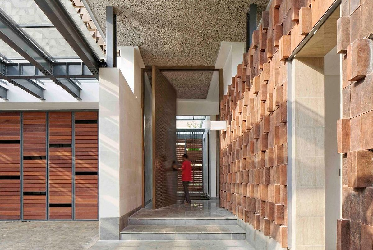 Ingenious facade of the house brings forth elements of traditional Javanese design