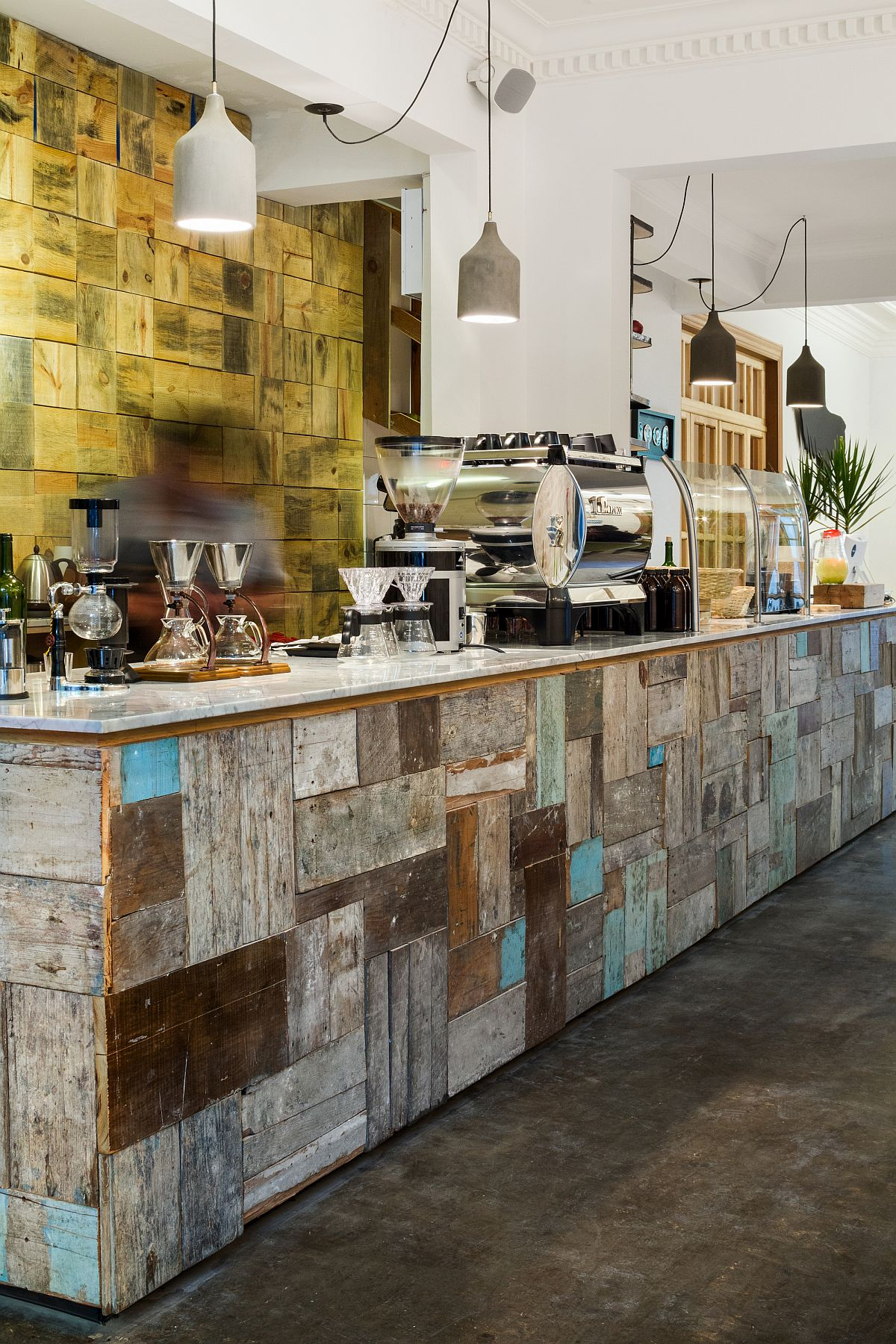 Interior of the coffee house uses reclaimed materials and colorful tiles