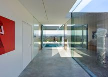 Interior of the minimal German villa with neutral hues and pops of bright colors