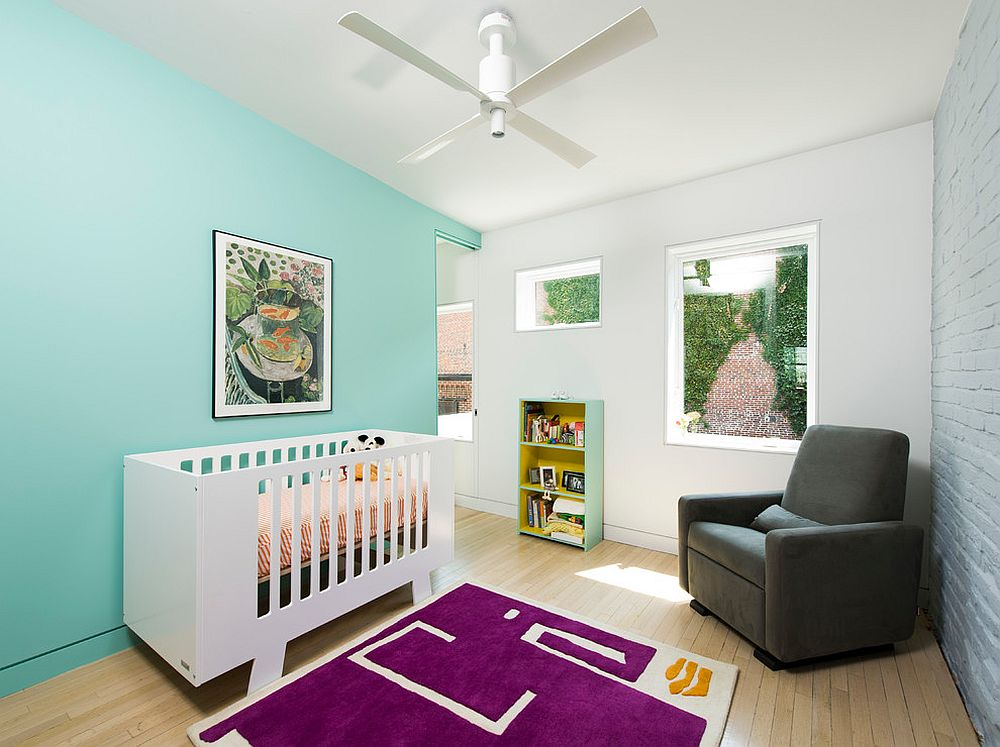 It is rug in bright violet that anchors this Scandinavian nursery