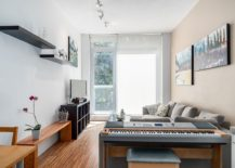 Keyboard-tucked-in-beautifully-behind-the-living-room-couch-217x155