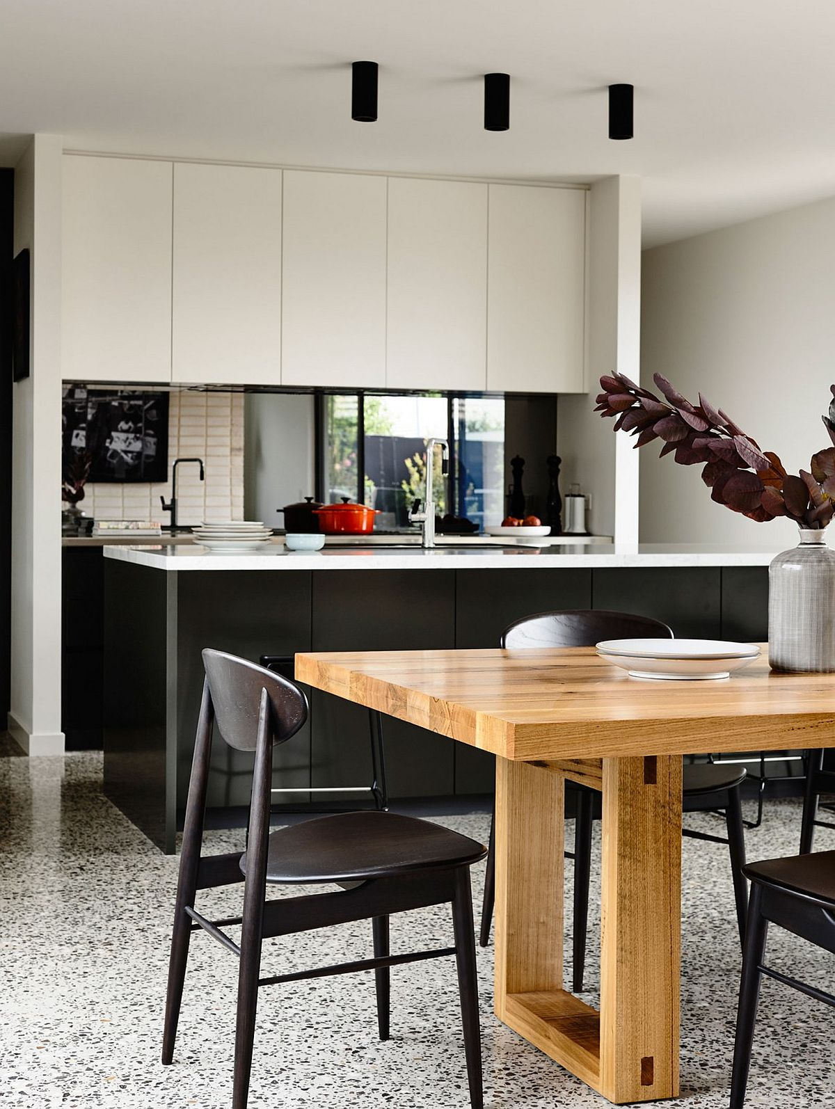 Kitchen and dining space of the Alphington House nestled in the single story pavilion structure