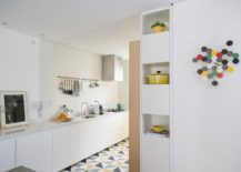 Kitchen in white with geometric floor tiles that add color and contrast