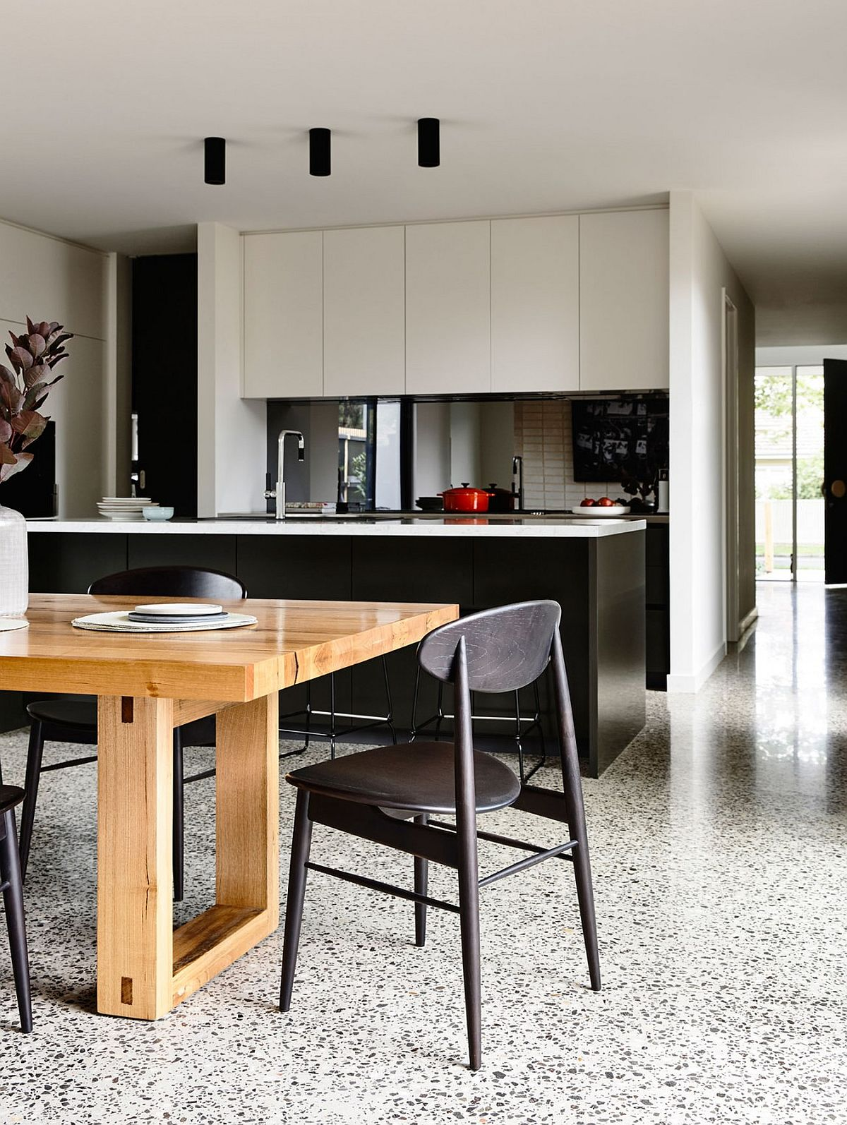 Kitchen island in black with a white countertop