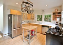 Kitchen with an overhead pot rack