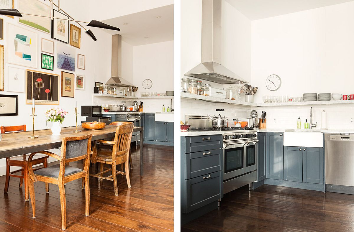L-shaped kitchen in the corner with grayish-blue cabinets with the dining space in the forefront