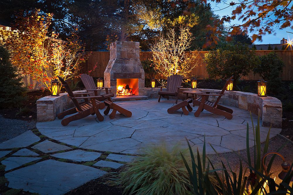 Lanterns and fireplace create a cozy and traditional outdoor hangout under the stars!
