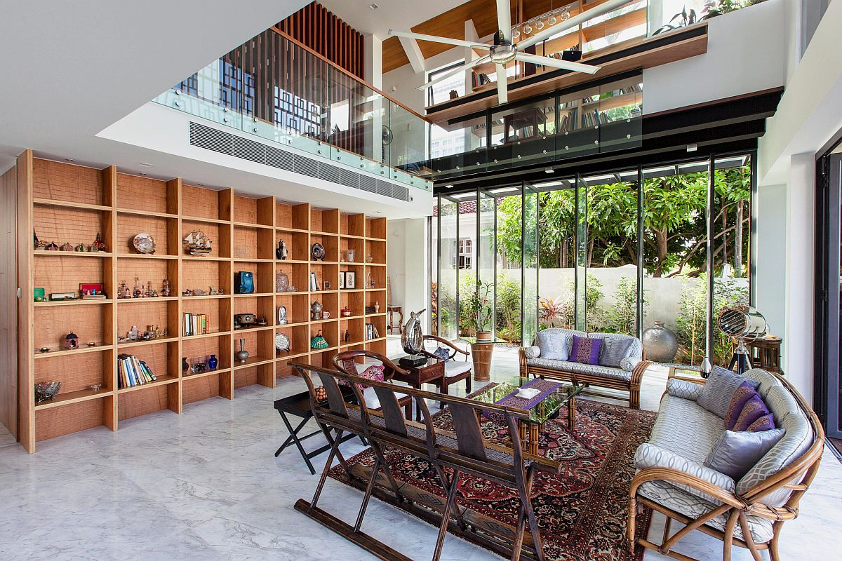 Large glass doors and open wooden shelf in the living space