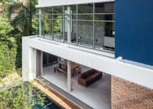 Large-sliding-glass-doors-and-windows-open-up-the-Thai-home-towards-the-patio-and-pool-area-217x155