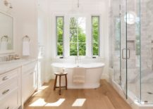 Light filled bathroom with a wooden stool 217x155 20 Tips for an Organized Bathroom
