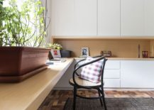 Long wooden desk provides ample space for work and a whole lot more