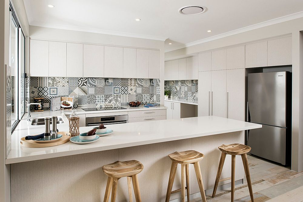 Lovely patchwork tiled backsplash in the kitchen adds color to the Scandinavian setting [Design: Jodie Cooper Design]