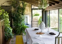 Lovely-sunroom-with-slanted-ceiling-and-a-dash-of-greenery-217x155