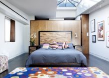 Luxurious bedroom of the New York penthouse with colorful rug and skylights