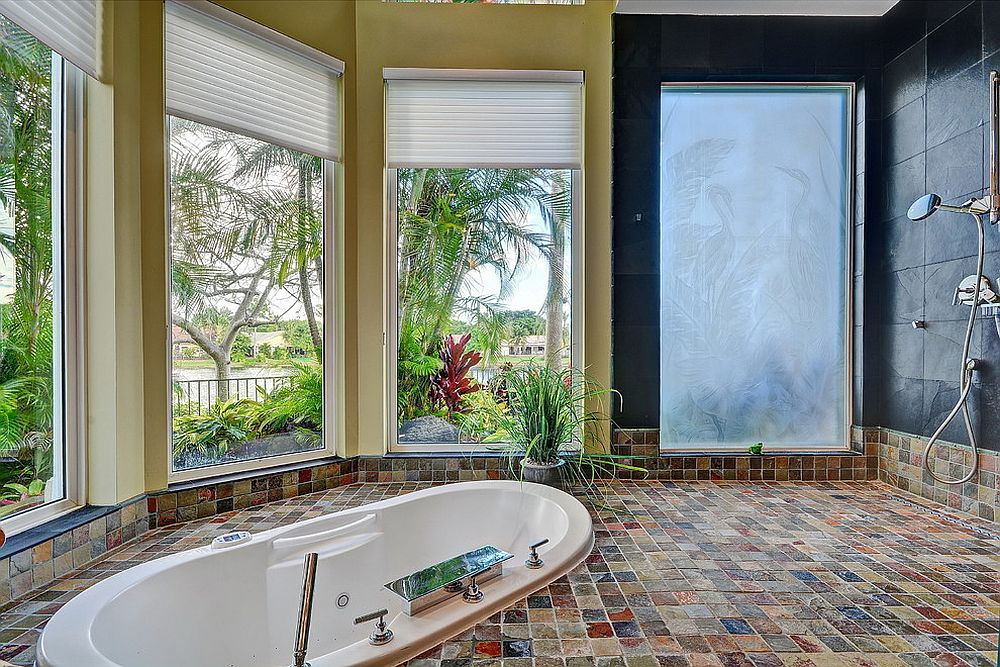 Luxurious tropical bathroom that opens up the view outside [Design: Shelly Preziosi Designs]